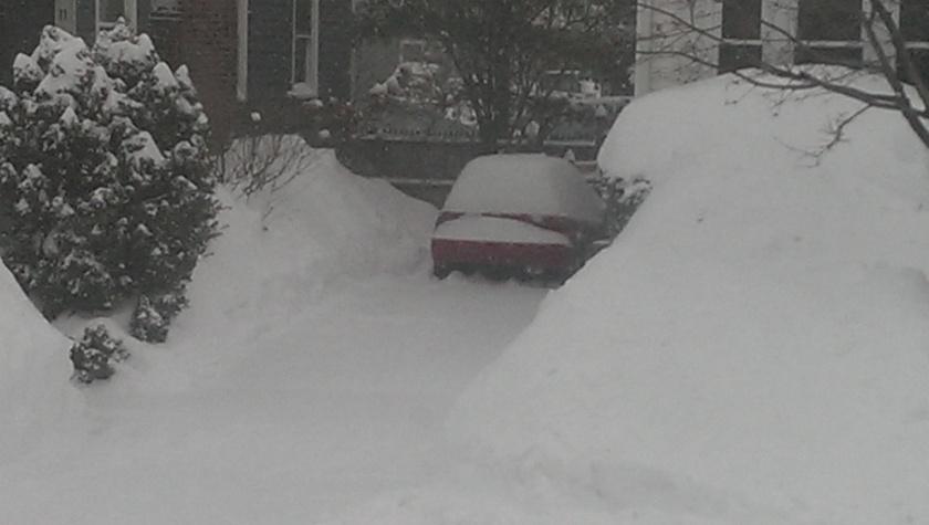 car in snowy driveway